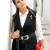 Gilet lungo nero e pantaloni con tucani: il look del giorno!